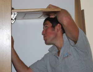 Darren installing a new kitchen.
